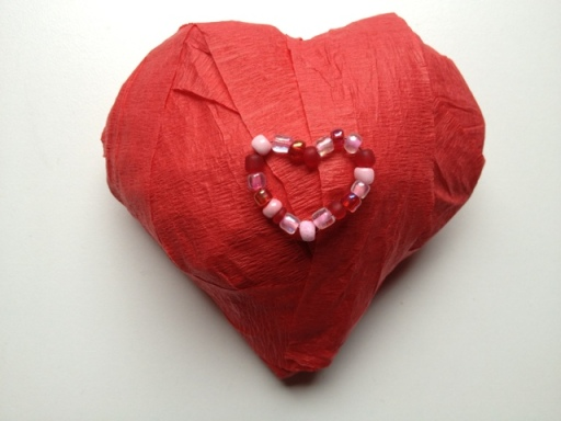 http://blog.celebratethebigandsmall.com/2012/01/17/easy-diy-heart-shaped-surprise-ball/